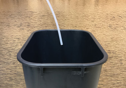 place the sample discharge line into an empty collection container